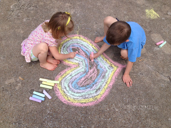 Kids drawing chalk heart