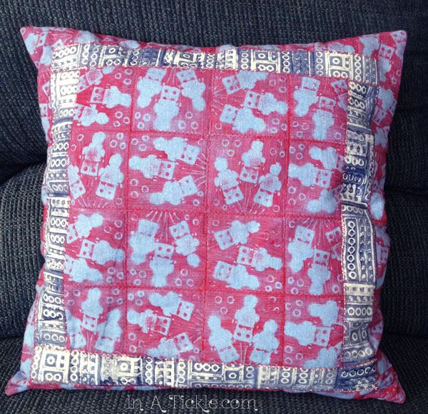 Pillow with hand printed fabric