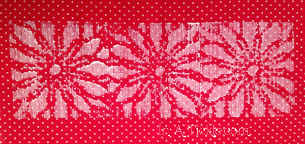 Stamped red polkadot fabric