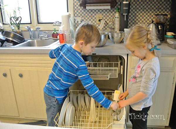Helping load dishes