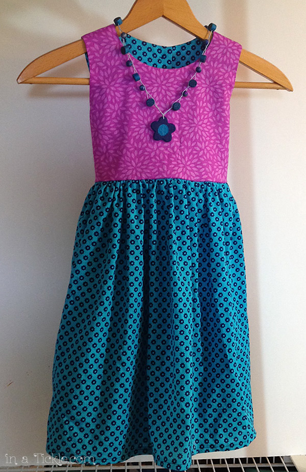 Dress-with-clay-necklace-and-buttons