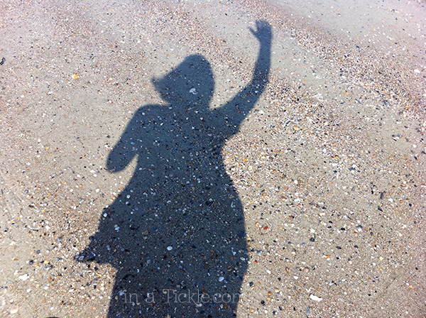Waving girl-beach-shadow
