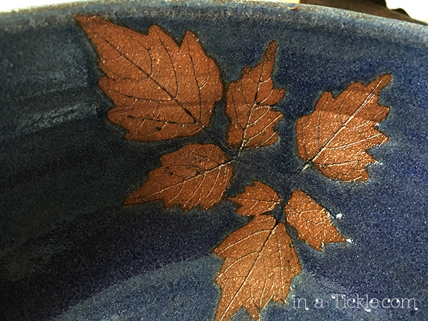 Blue-pottery-peppervine-leaves